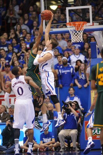 Jeff Withey gets a hand on a shot by Baylor forward Perry Jones.