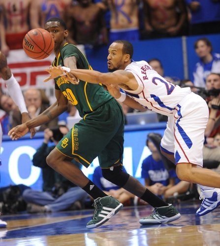 Kansas junior Travis Releford reaches for a loose ball against Baylor's Quincy Miller in the second half on Monday January 16, 2012 in Allen Fieldhouse.