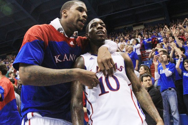 Kansas forward Thomas Robinson gives teammate Tyshawn Taylor a hug, at the end of regulation play as the two combined for a total 55 points against Baylor on Monday January 16, 2012 in Allen Fieldhouse.