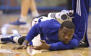 Kansas guard Tyshawn Taylor stretches out prior to tipoff against Baylor on Monday, Jan. 16, 2012 at Allen Fieldhouse.