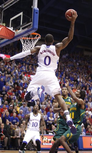 Kansas forward Thomas Robinson gets up for an alley-oop over Baylor defenders Perry Jones III and Anthony Jones (41) during the first half on Monday, Jan. 16, 2012 at Allen Fieldhouse.