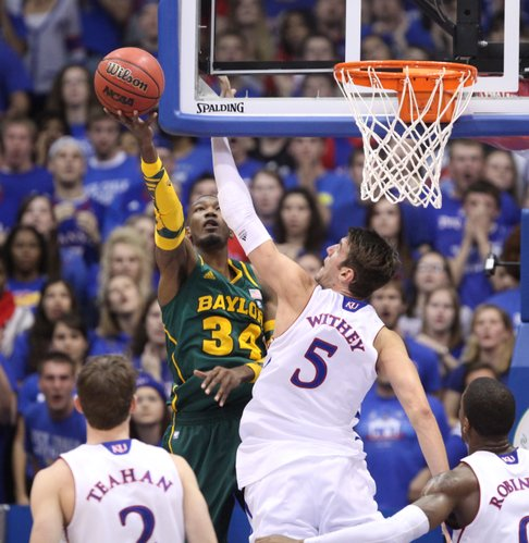 Kansas center Jeff Withey defends as Baylor forward Cory Jefferson scoops a shot from behind the backboard during the first half on Monday, Jan. 16, 2012 at Allen Fieldhouse.