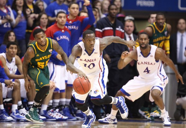 Kansas guard Tyshawn Taylor comes away with a loose ball as he breaks up the court past Baylor guard Pierre Jackson and teammate Justin Wesley during the first half on Monday, Jan. 16, 2012 at Allen Fieldhouse.
