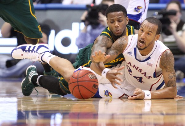 Kansas guard Travis Releford wrestles on the floor for a loose ball with Baylor guard Pierre Jackson during the first half on Monday, Jan. 16, 2012 at Allen Fieldhouse.