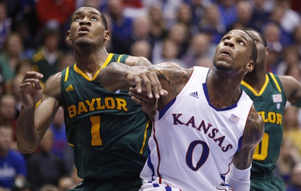Kansas forward Thomas Robinson wrestles for position with Baylor forward Perry Jones III during the first half on Monday, Jan. 16, 2012 at Allen Fieldhouse.