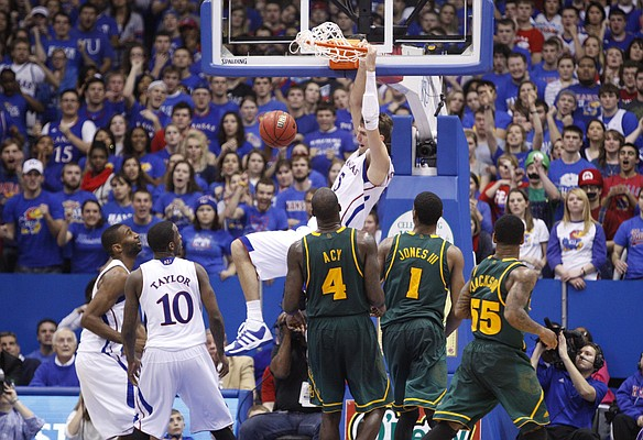 Kansas center Jeff Withey delivers home a jam against Baylor during the second half on Monday, Jan. 16, 2012 at Allen Fieldhouse.
