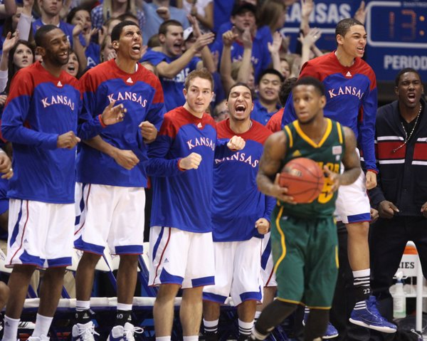 The Kansas bench goes wild during a Jayhawk run in the second half on Monday, Jan. 16, 2012 at Allen Fieldhouse.