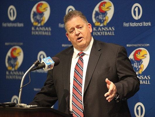 Kansas head football coach Charlie Weis talks with media members on Monday, Jan. 16, 2012 at the Anderson Family Football Complex. Weis introduced new members of his football team and also announced players that have left the program.