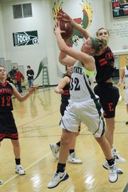 Free State's Chelsea Casady gets the rebound against Emporia's Kayna Hastings on Tuesday, January 17, 2012, at FSHS.