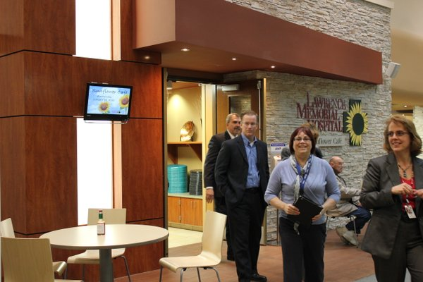 Lawrence Memorial Hospital communications director Janice Early, center, finishes a tour of the newly renovated kitchen and dining areas with board members. She's followed by Rob Chestnut and Andy Ramirez. The renovation work features Kansas limestone and new tile.