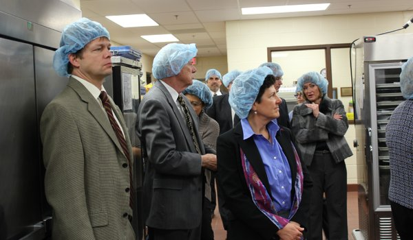 Lawrence Memorial Hospital board members take a tour Wednesday, Jan. 18, 2012, of the newly-renovated kitchen. In front, from left, are Dr. Lee Reussner, Chuck Heath and Judy Keller. LMH spent approximately $3.2 million to update its dining area and 1970s-era kitchen.