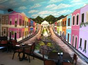 Tapas restaurant in Downtown Lawrence has commissioned a mural of an old Mexican town for its upstairs dining room. The restaurant plans to have several other murals painted in its main floor dining area as well.