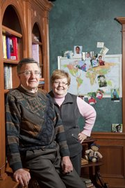 Sherry Schaub, a retired executive at Quaker Oats, has been chairman of Kids Alive International for more than two decades. With his wife, Carol, Sherry has traveled around the world helping the organization build homes and schools for at risk children in third world countries. The couple sponsor 11 children, whose pictures and countries are pinned into the map behind them.