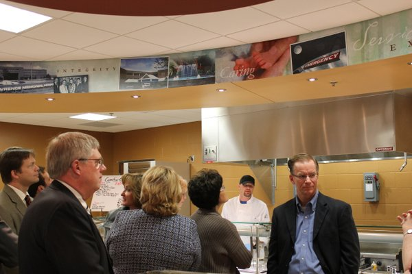 Lawrence Memorial Hospital board members tour the newly-renovated dining service area Wednesday, Jan. 18, 2012. The area features a panoramic mural.