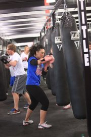 Kansas University student Jennifer Bui works out Jan. 16, 2012, at Title Boxing Club, 1520 Wakarusa Drive.