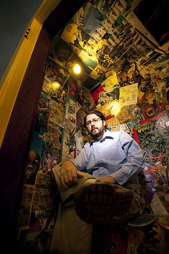 Kansas University alum, Lawrence resident and comic book writer Jai Nitz is pictured at the former Astrokitty Comics and More location, 15 E. Seventh St., in this 2012 file photo.