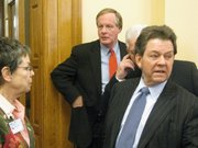 Consultant Arthur Laffer enters legislative committee room on Thursday to tout Gov. Sam Brownback's tax plan. Behind Laffer is Kansas Department of Revenue Secretary Nick Jordan. Laffer is being paid $75,000 by the Brownback administration to help with the tax proposal.