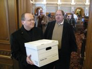 Revs. Tobias Schlingensiepen and Jim McCollough on Thursday deliver petition signatures in the Capitol seeking ouster of House Speaker Mike O'Neal, R-Hutchinson, over recent emails he has forwarded.