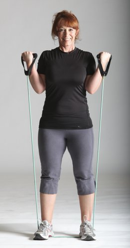 Bicep curl using a resistance band. Stand on top of the band with equal lengths on both sides to stabilize it.