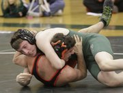 Mike Yoder/Journal-World Photo.Free State wrestler Colton Steele, top, got a quick pin of Jorge Amunatigui during their 145-pound weight class match during a Firebirds home wrestling meet Wed. Jan. 18, against Shawnee Mission Northwest.