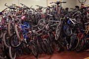 Stacks of bicycles fill a room at the Lansing Correctional Facility. The bicycles are refurbished by inmates and sent back into the community.