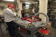 Inmate William King works on a bicycle Jan. 18 at Lansing Correctional Facility. The prison's bicycle repair shop serves the dual function of employing inmates and providing bicycles to those who need them. Since 1999, the shop has donated more than 4,700 bicycles around the area.