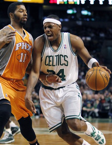 Boston Celtics' Paul Pierce (34) drives past Phoenix Suns' Markieff Morris (11) in the first quarter of an NBA basketball game in Boston on Friday, Jan. 20, 2012.