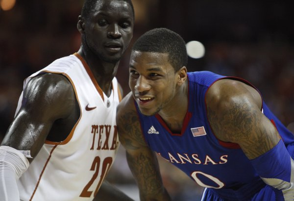 Kansas forward Thomas Robinson smiles as he waits for the inbound while guarded by Texas forward Alexis Wangmene during the first half on Saturday, Jan. 21, 2012 at the Frank Erwin Center.