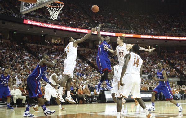 Kansas guard Tyshawn Taylor lofts a shot over Texas forward Sheldon McClellan (2) for a bucket during the second half on Saturday, Jan. 21, 2012 at the Frank Erwin Center.