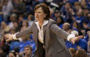 Kansas coach Bonnie Henrickson motions to her team during Kansas' game against Texas A&M Saturday, Jan. 21, 2012 at Allen Fieldhouse. The Jayhawks lost the game, 76-65.