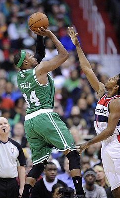 Boston Celtics forward Paul Pierce (34) takes a shot against Washington Wizards guard Nick Young (1) during the second half of an NBA basketball game on Sunday, Jan. 22, 2012, in Washington. The Celtics won 100-94.