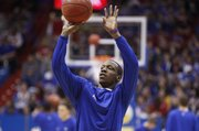 Kansas guard Tyshawn Taylor puts up a shot prior to tipoff against Texas A&M on Monday, Jan. 23, 2012 at Allen Fieldhouse.