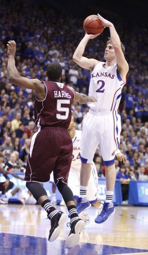 Kansas guard Conner Teahan pulls up for a jumper over Texas A&M guard Dash Harris during the first half on Monday, Jan. 23, 2012 at Allen Fieldhouse.
