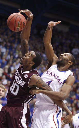Texas A&M forward David Loubeau pulls a rebound from Kansas forward Justin Wesley during the first half on Monday, Jan. 23, 2012 at Allen Fieldhouse.