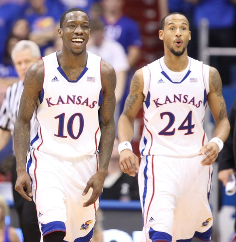 Kansas players Tyshawn Taylor (10) and Travis Releford (24) react after Taylor was not called for a foul on an attempted steal during the second half on Monday, Jan. 23, 2012 at Allen Fieldhouse.