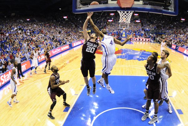 Kansas forward Justin Wesley fights for a rebound with Texas A&M forward Daniel Alexander during the second half on Monday, Jan. 23, 2012 at Allen Fieldhouse.