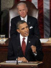President Barack Obama gives State of the Union address on Capitol in Washington, Tuesday, Jan. 24, 2012. Vice President Joe Biden is behind the president.