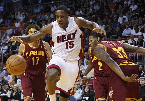 Miami Heat's Mario Chalmers (15) loses the ball as Cleveland Cavaliers' Alonzo Gee (33) defends during the first half of an NBA basketball game, Tuesday, Jan. 24, 2012, in Miami.