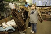 A girl reacts to the smell of a friend's fur coat as they prepare for a hike at the Prairie Park Nature Center. In my search for a feature from this unique situation, I thought this scene was a little too cluttered and didn't emphasize the coats as much as I wanted. .