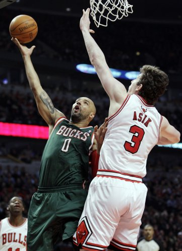 Milwaukee Bucks center Drew Gooden (0) shoots over Chicago Bulls center Omer Asik (3) during the first quarter of an NBA basketball game in Chicago on Friday, Jan. 27, 2012.