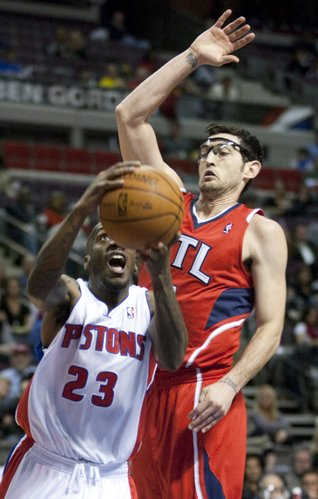 Detroit Pistons' Walker Russell (23) goes to the basket past Atlanta Hawks' Kirk Hinrich in the fourth quarter of an NBA basketball game on Friday, Jan. 27, 2012, in Auburn Hills, Mich. The Hawks defeated the Pistons 107-101 in overtime.