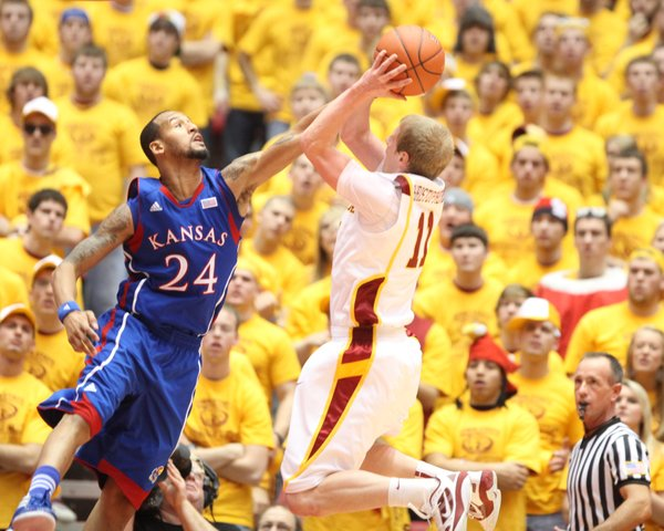 Kansas guard Travis Releford defends a shot from Iowa State guard Scott Christopherson during the second half on Saturday, Jan. 28, 2012 at Hilton Coliseum.