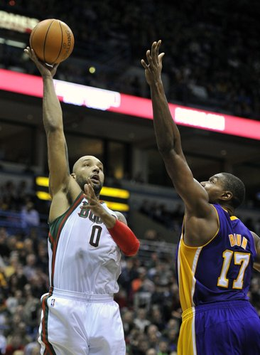 Milwaukee Bucks' Drew Gooden (0) shoots the ball over Los Angeles Lakers' Andrew Bynum (17) during the second half of an NBA basketball game on Saturday, Jan. 28, 2012, in Milwaukee. The Bucks defeated the Lakers 100-89.