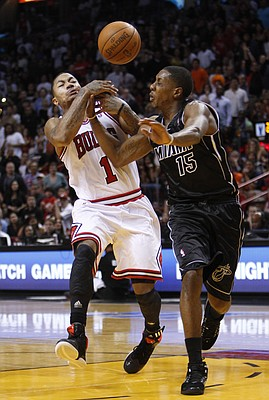 Chicago Bulls guard Derrick Rose (1) loses control of the ball as he goes up for a shot against Miami Heat guard Mario Chalmers (15) during the second half of an NBA basketball game against the Miami Heat, Sunday, Jan. 29, 2012, in Miami. Rose scored 34 points for Chicago, but missed a pair of foul shots that would have given Chicago the lead with 22.7 seconds left. The Heat defeated the Bulls 97-93.
