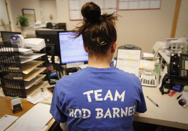 Lawrence Family Medicine and Obstetrics employee Trisha Tyree wears a T-shirt in support of Dr. Rod Barnes during work on Monday.