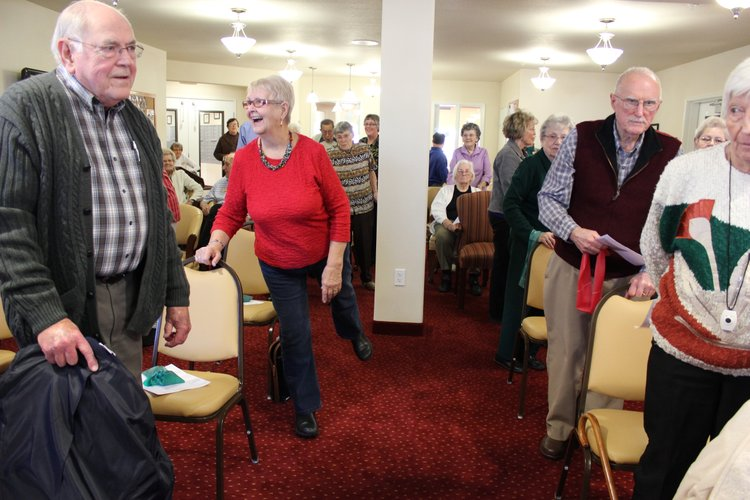 Marge Borom, 79, of Lawrence, second from left, does an exercise that helps improve balance and coordination during a fall prevention program Tuesday, Jan. 31, 2012, at Meadowlark Estates. Borom said the program was helpful and reminded her about the importance of exercise.