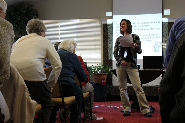 Stacia Bone, a physical therapist at Lawrence Memorial Hospital's Therapy Services, leads a group of about 50 people in exercises to help improve strength, balance and coordination. She spoke during a program on fall prevention Tuesday, Jan. 31, 2012, at Meadowlark Estates.