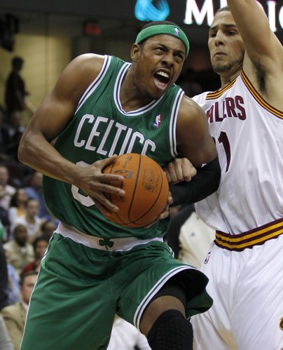 Boston Celtics' Paul Pierce, left, drives to the basket under pressure from Cleveland Cavaliers' Mychel Thompson during the first half of an NBA basketball game in Cleveland on Tuesday, Jan. 31, 2012.