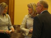 Ali Shutt (left) and Carie Lawrence speak with legislators on Wednesday after a hearing before the Senate Transportation Committee on a bill that would designate highway safety corridors and double fines on those roads. Transportation officials say they want to make Kansas Highway 10 a safety corridor. Last April, 5-year-old Cainan Shutt was killed in an accident where a vehicle crossed over the median and struck the van he was riding in. His mother, Ali, and grandmother, Carie, attended the committee hearing.