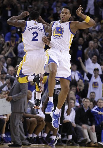 Golden State Warriors' Brandon Rush, right, and Nate Robinson (2) celebrate in the final minutes of the NBA basketball game against the Sacramento Kings Tuesday, Jan. 31, 2012, in Oakland, Calif.